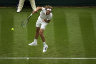 Germany's Alexander Zverev serves to Tallon Griekspoor of the Netherlands during the men's singles first round match on day two of the Wimbledon Tennis Championships in London, Tuesday June 29, 2021. (AP Photo/Alberto Pezzali)