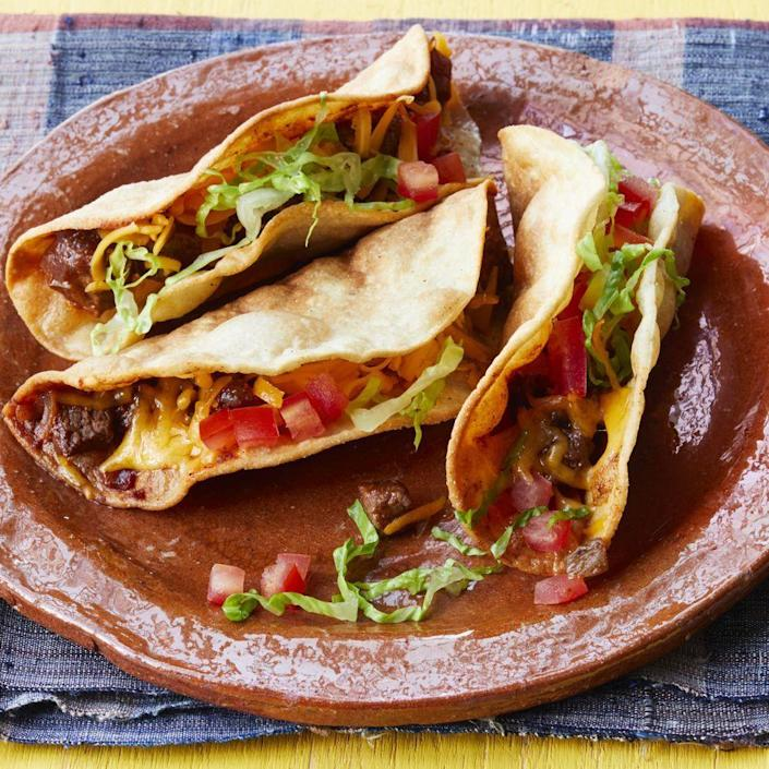 """<p>If you've never fried tacos before, we promise you won't be disappointed. Cut your leftover steak into ½-inch pieces so it's bite-sized enough for the crispy taco shells. </p><p><a href=""""https://www.thepioneerwoman.com/food-cooking/recipes/a35726509/fried-beef-tacos/"""" rel=""""nofollow noopener"""" target=""""_blank"""" data-ylk=""""slk:Get Ree's recipe."""" class=""""link rapid-noclick-resp""""><strong>Get Ree's recipe.</strong> </a></p><p><a class=""""link rapid-noclick-resp"""" href=""""https://go.redirectingat.com?id=74968X1596630&url=https%3A%2F%2Fwww.walmart.com%2Fsearch%2F%3Fquery%3Dpioneer%2Bwoman%2Bcast%2Biron%2Bskillets&sref=https%3A%2F%2Fwww.thepioneerwoman.com%2Ffood-cooking%2Frecipes%2Fg37180949%2Fleftover-steak-recipes%2F"""" rel=""""nofollow noopener"""" target=""""_blank"""" data-ylk=""""slk:SHOP CAST IRON SKILLETS"""">SHOP CAST IRON SKILLETS</a></p>"""