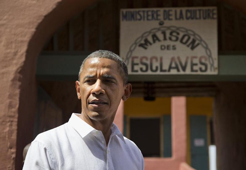 President Barack Obama pauses during a statement after taking a tour of Goree Island, Thursday, June 27, 2013, in Goree Island, Senegal. Goree Island is the site of the former slave house and embarkation point built by the Dutch in 1776, from which slaves were brought to the Americas. (AP Photo/Evan Vucci)