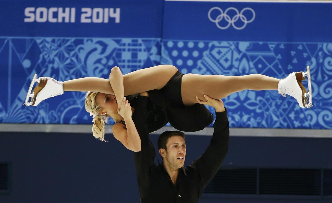 Kirsten Moore-Towers and Dylan Moscovitch of Canada compete during the Team Pairs Free Skating Program at the Sochi 2014 Winter Olympics, February 8, 2014. REUTERS/Lucy Nicholson (RUSSIA - Tags: SPORT FIGURE SKATING SPORT OLYMPICS)