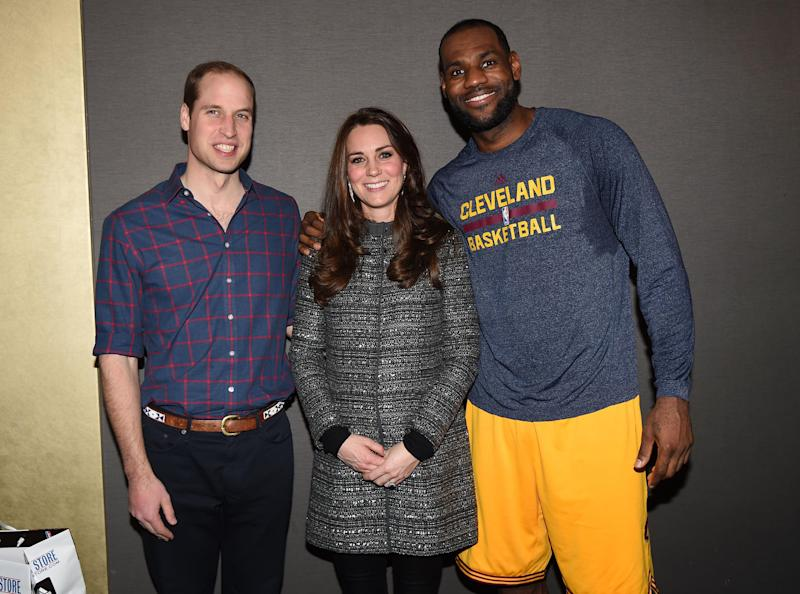 Prince William and Catherine, Duchess of Cambridge pose with LeBron James as they attend a Cleveland Cavaliers vs. Brooklyn Nets game on Dec. 8, 2014. (Pool via Getty Images)