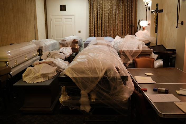 Bodies wait in an overflow room at the Gerard Neufeld funeral home on April 22 in Elmhurst. The funeral home, which is close to Elmhurst Hospital, often had to take the phone off the hook as it rang continually. (Spencer Platt/Getty Images)