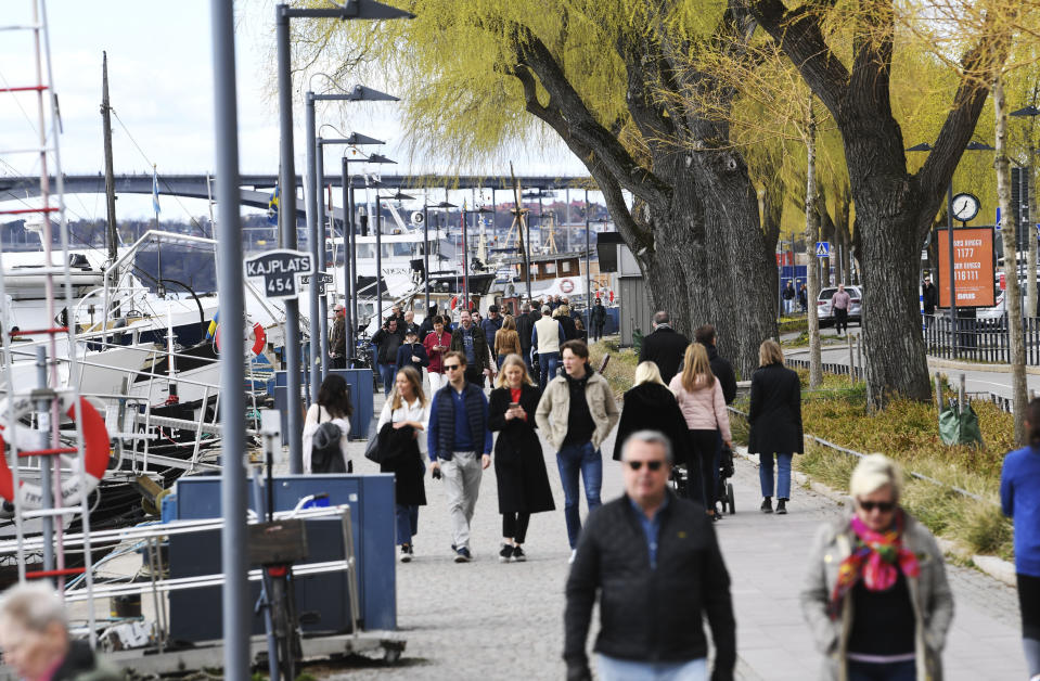 People take a stroll at Norr Mälarstrand street in Stockholm, Sweden, on April 19, 2020, amid the new coronavirus COVID-19 pandemic. (Photo by Fredrik SANDBERG / TT News Agency / AFP) / Sweden OUT (Photo by FREDRIK SANDBERG/TT News Agency/AFP via Getty Images)