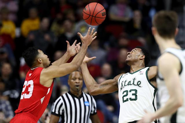 <p>Xavier Tillman #23 of the Michigan State Spartans and Dwayne Lautier-Ogunleye #23 of the Bradley Braves go after a loose ball during their game in the First Round of the NCAA Basketball Tournament at Wells Fargo Arena on March 21, 2019 in Des Moines, Iowa. (Photo by Jamie Squire/Getty Images) </p>