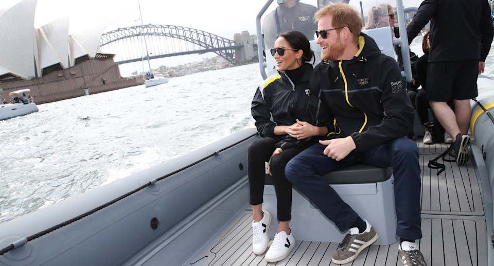 Meghan Markle wearing her $150 Veja V-10 sneakers during a trip to Australia (Photo via Getty)