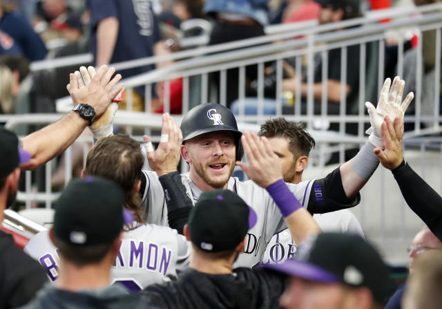 Colorado Rockies' Trevor Story celebrates after hitting a home run in the fourth inning of a baseball game against the Atlanta Braves, Friday, April 26, 2019, in Atlanta. (AP Photo/John Bazemore)