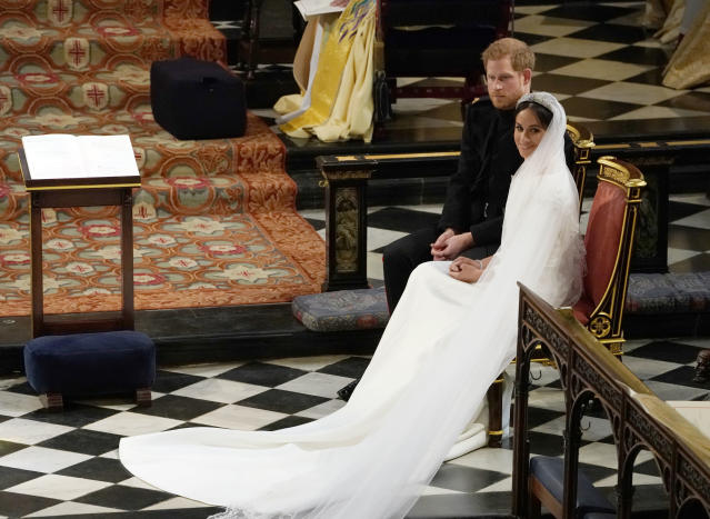 <p>Prince Harry and Meghan Markle during their wedding ceremony in St George's Chapel at Windsor Castle. (Photo: Owen Humphreys – WPA Pool/Getty Images) </p>