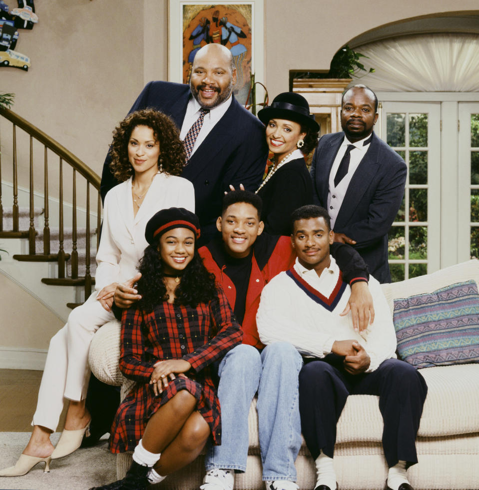 THE FRESH PRINCE OF BEL-AIR -- Season 4 -- Pictured: (l-r) Back: Karyn Parsons as Hilary Banks, James Avery as Philip Banks, Daphne Reid as Vivian Banks, Joseph Marcell as Geoffrey; Front: Tatyana Ali as Ashley Banks, Will Smith as William 'Will' Smith, Alfonso Ribeiro as Carlton Banks  (Photo by Chris Haston/NBCU Photo Bank/NBCUniversal via Getty Images via Getty Images)