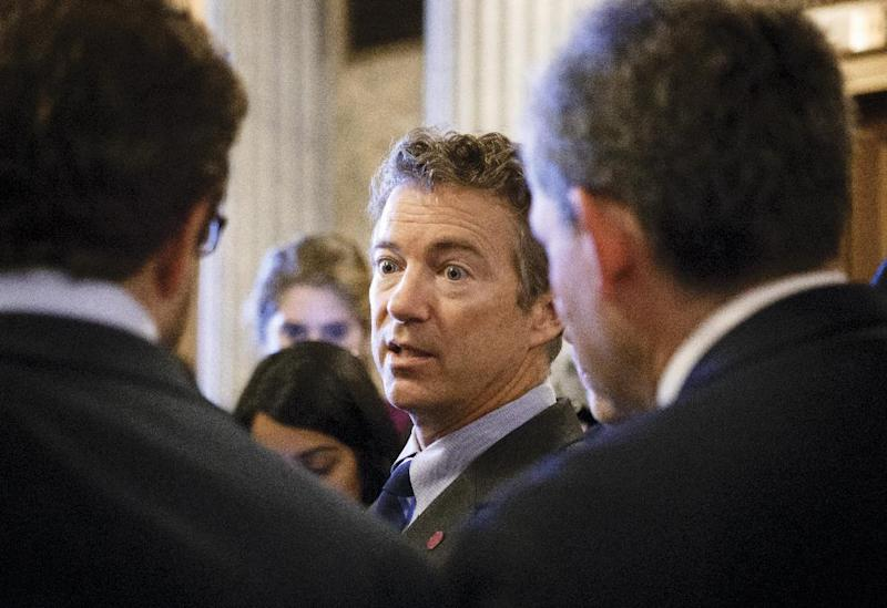 FILE - In this Sept. 25, 2013, file photo, Sen. Rand Paul, R-Ky. leaves the Senate chamber on Capitol Hill in Washington, Wednesday, after a procedural vote on a bill to fund the government. Potential 2016 presidential candidates now in Congress, including Paul, have been relatively silent about a partial government shutdown. (AP Photo/J. Scott Applewhite, File)