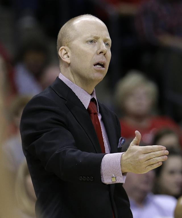 Cincinnati coach Mick Cronin watches the action during the first half of an NCAA college basketball game against Connecticut in the semifinals of the American Athletic Conference men's tournament Friday, March 14, 2014, in Memphis, Tenn. (AP Photo/Mark Humphrey)