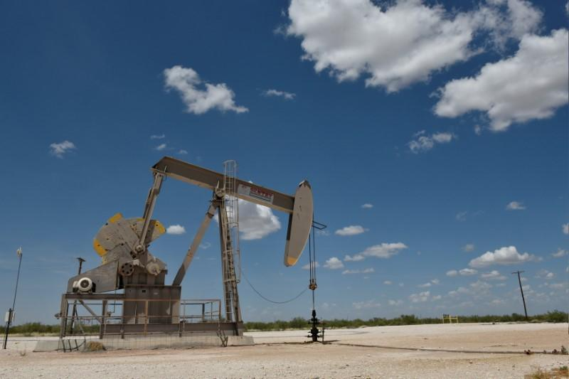 FILE PHOTO: A pump jack operates in the Permian Basin oil production area near Wink, Texas U.S. August 22, 2018. REUTERS/Nick Oxford/File Photo