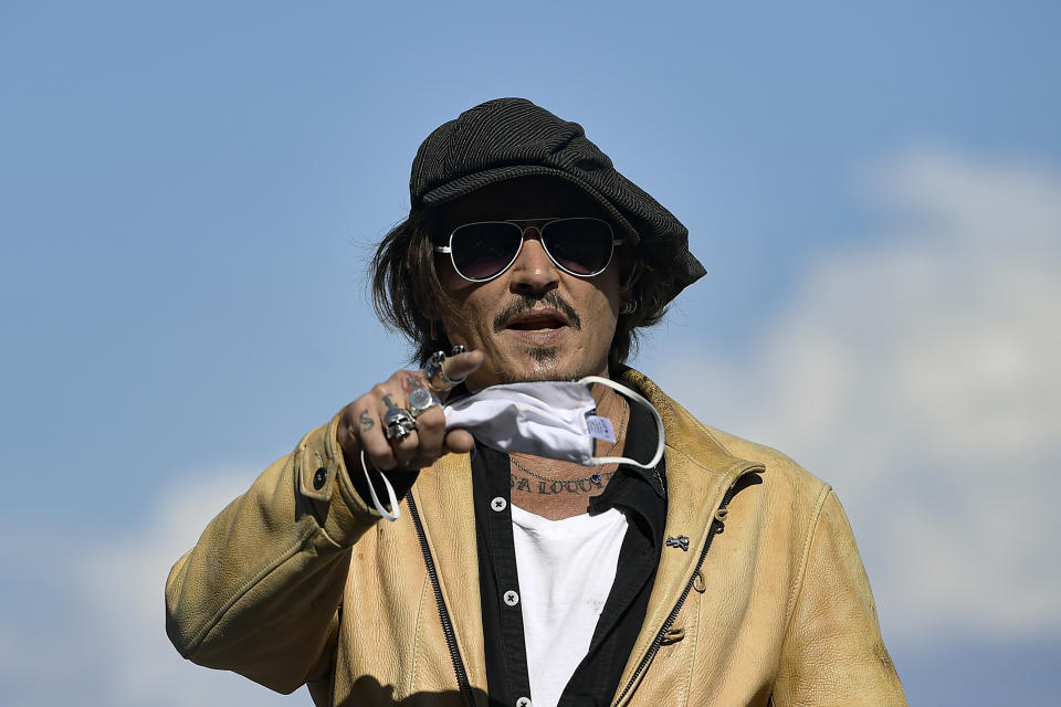 "US actor and film producer Johnny Deep, gestures during the photocall to promotes his film ""Crock of Gold: A Few Rounds with Shane Macgoman"" at the 68th San Sebastian Film Festival, in San Sebastian, northern Spain, Sunday, Sept. 20, 2020. (AP Photo/Alvaro Barrientos)"