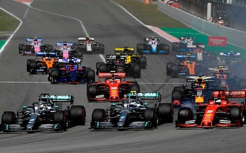 Mercedes' British driver Lewis Hamilton (L) overtakes Mercedes' Finnish driver Valtteri Bottas (C) next to Ferrari's German driver Sebastian Vettel (R) at the start of the Spanish Formula One Grand Prix at the Circuit de Catalunya in Montmelo in the outskirts of Barcelona on May 12, 2019. - Credit: AFP