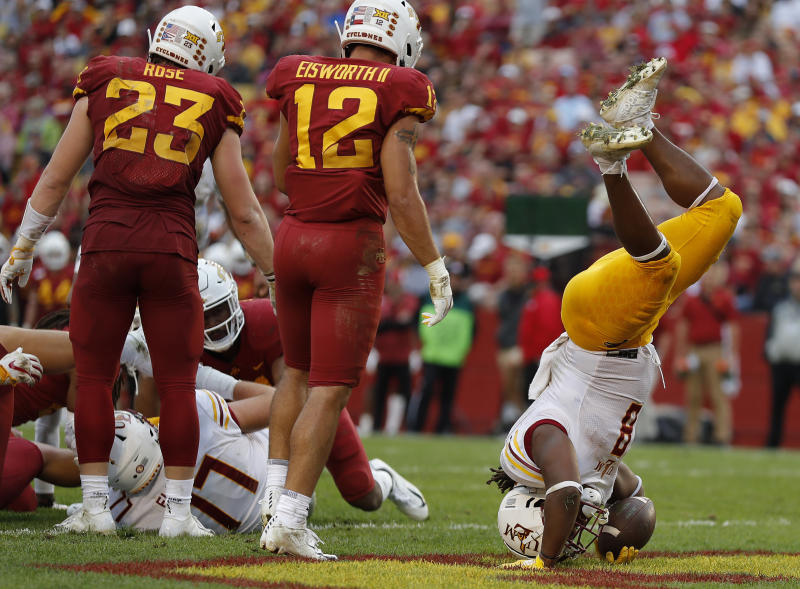 RETRANSMISSION TO CORRECT DATE - Louisiana-Monroe running back Josh Johnson, right, is flipped as he dives into the end zone for a touchdown against Iowa State during the first half of an NCAA college football game, Saturday, Sept. 21, 2019, in Ames, Iowa. (AP Photo/Matthew Putney)