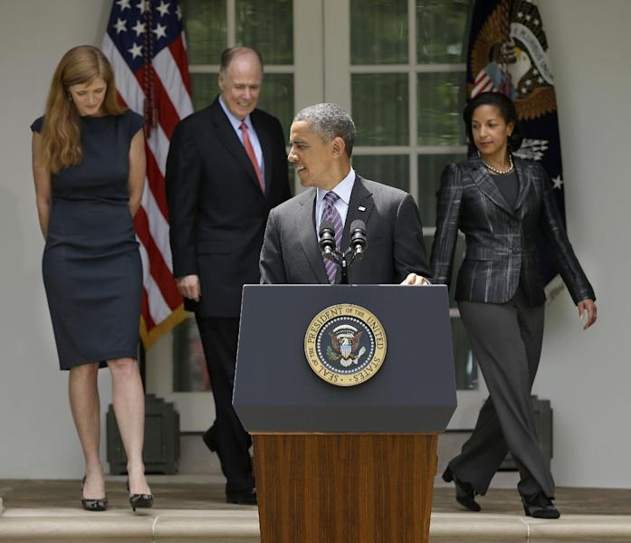 President Barack Obama waits at the podium in the Rose Garden of the White House in Washington. Wednesday, June 5, 2013, for, from left, Samantha Power, his nominee to be the next UN Ambassador, National Security Advisor Tom Donilon, who is resigning and current UN Ambassador Susan Rice, right, as his choice to be his next National Security Advisor, prior to making the announcment. (AP Photo/Pablo Martinez Monsivais)