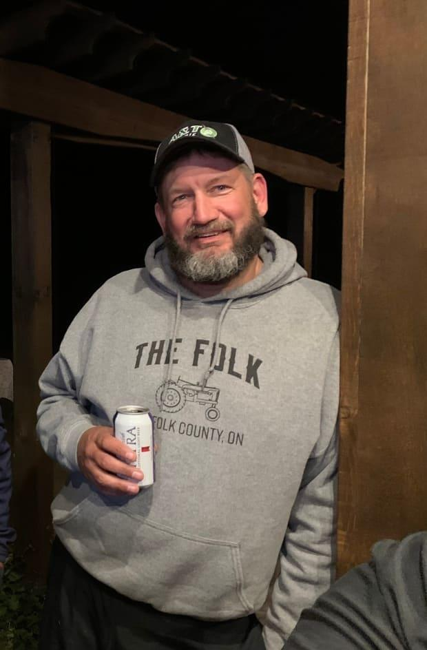Norfolk County chicken farmer Mike VanNetten, 45, has returned home after a long battle against COVID-19. (Sarah VanNetten - image credit)