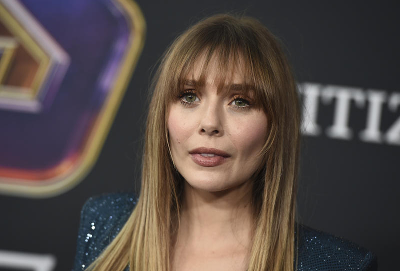 "Elizabeth Olsen arrives at the premiere of ""Avengers: Endgame"" at the Los Angeles Convention Center on Monday, April 22, 2019. (Photo by Jordan Strauss/Invision/AP)"