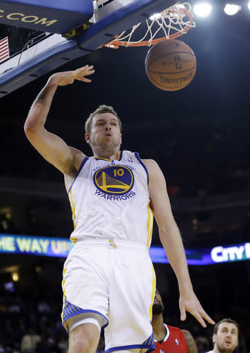 Golden State Warriors' David Lee dunks against the Los Angeles Clippers during the second half of an NBA basketball game on Thursday, Jan. 30, 2014, in Oakland, Calif. Golden State won 111-92. (AP Photo)