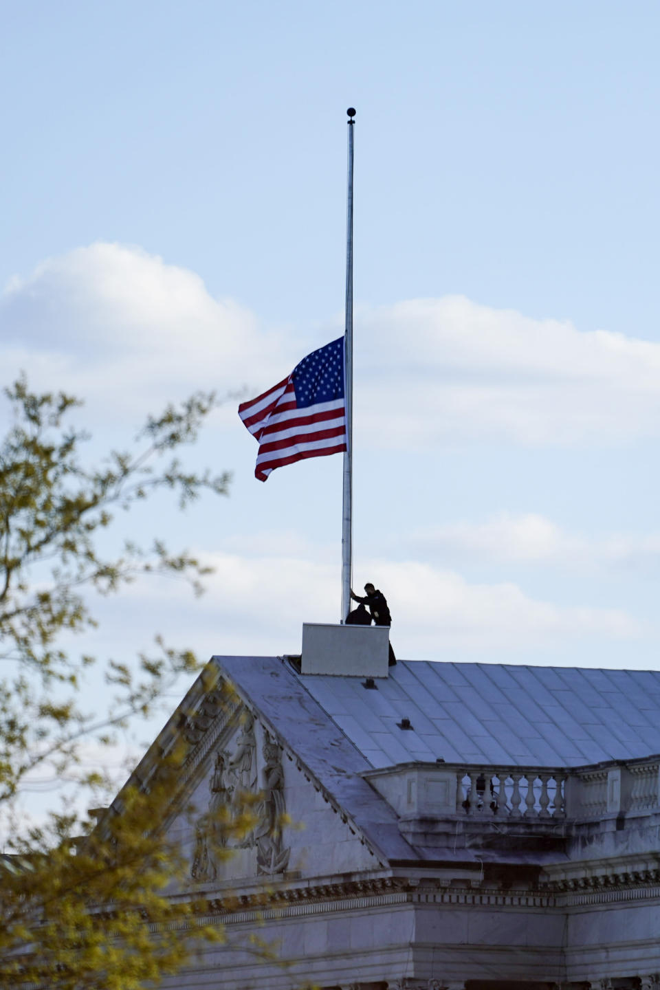 The American flag at the U.S. Capitol is lowered to half-staff in honor of Capitol Police officer William Evans who was killed after a man rammed a car into two officers at a barricade outside the U.S. Capitol in Washington, Friday, April 2, 2021. (AP Photo/Alex Brandon)