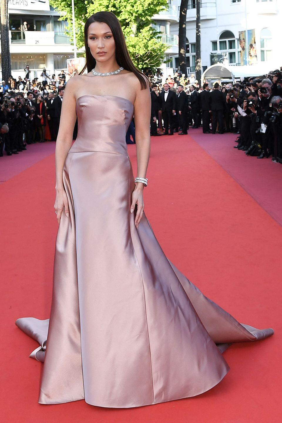 """<p>in a strapless silk blush pink gown with a diamond choker, bracelets, and ring at the <a href=""""https://www.harpersbazaar.com/celebrity/red-carpet-dresses/g20529068/cannes-2018-red-carpet/"""" rel=""""nofollow noopener"""" target=""""_blank"""" data-ylk=""""slk:Cannes Film Festival"""" class=""""link rapid-noclick-resp"""">Cannes Film Festival</a>.</p>"""