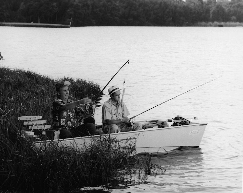 <p>Ed McMahon fishes with Bob Newhart from a rowboat in Cypress Gardens, Florida in 1972.</p>