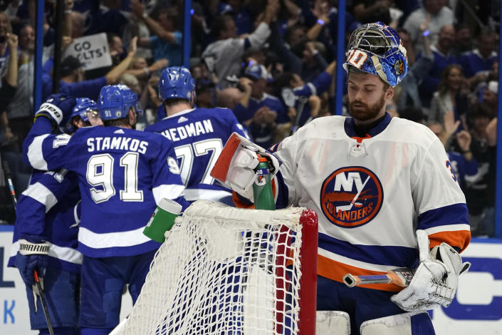 New York Islanders goaltender Ilya Sorokin, right, reacts after Tampa Bay Lightning players celebrate another goal during the second period in Game 5 of an NHL hockey Stanley Cup semifinal playoff series Monday, June 21, 2021, in Tampa, Fla. (AP Photo/Chris O'Meara)