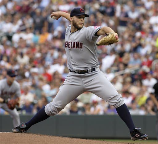 Cleveland Indians starting pitcher Justin Masterson delivers during the first inning against the Minnesota Twins in a baseball game, Saturday, July 28, 2012, in Minneapolis. (AP Photo/Paul Battaglia)