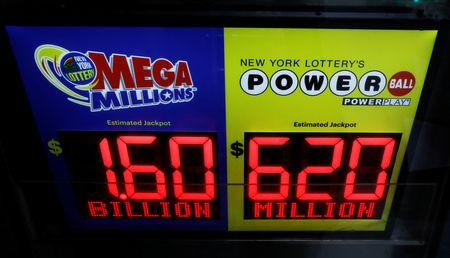 Signs display the jackpots for Tuesday's Mega Millions and Wednesday's Powerball lottery drawings in New York City, U.S., October 22, 2018. REUTERS/Brendan McDermid