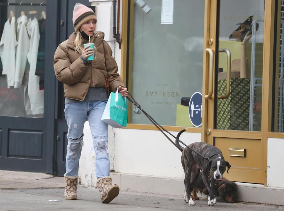 <p>Sienna Miller is seen walking her dogs outside of Daylesford Organic farm shop on Tuesday in London.</p>