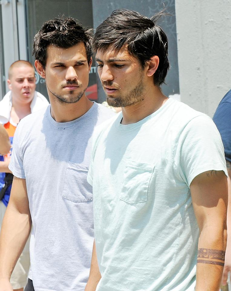 "NEW YORK, NY - JUNE 24:  Taylor Lautner with his stunt double on the set of ""Tracers"" on June 24, 2013 in New York City.  (Photo by Bobby Bank/WireImage)"