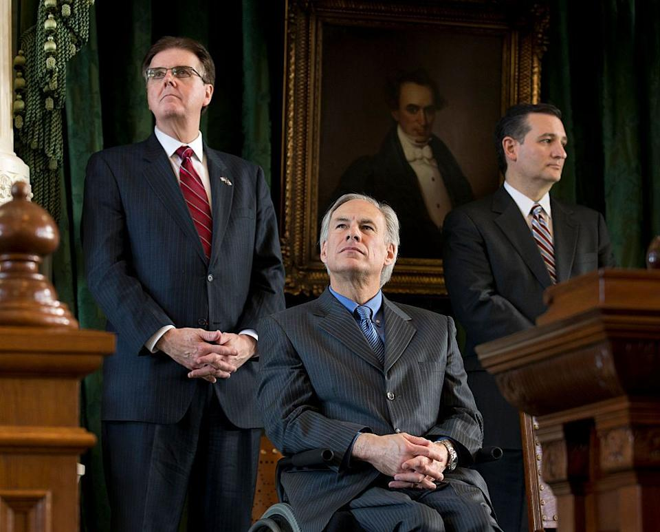 Texas' incoming Lt. Gov. Dan Patrick (left) and Gov. Greg Abbott listen, alongside Sen. Ted Cruz, during transition ceremonies at the Texas Capitol in January 2015. (Photo: Robert Daemmrich Photography Inc./Corbis/Getty Images)