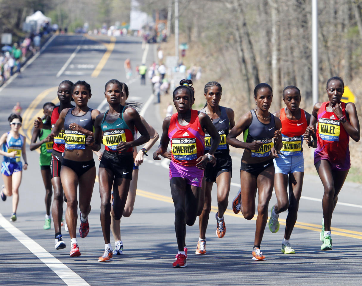 Elite women runners, including Genet Getaneh, left, of Ethiopia; Georgina Rono, second from left, and Sharon Cherop, third from left, of Kenya; Firehiwot Dado, third from right, of Ethiopia; and Jemima Jelagat Sumgong, second from right, and Caroline Kilel, right, of Kenya, compete in the Boston Marathon in Wellesley, Mass., Monday, April 16, 2012. (AP Photo/Michael Dwyer)