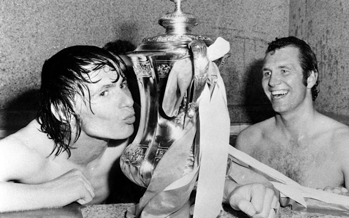 FA Cup hero Bobby Stokes celebrates by kissing the famous trophy - PA