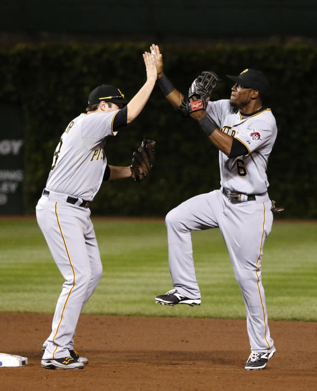 Pittsburgh Pirates' Starling Marte, right, celebrates with second baseman Neil Walker the Pirates' 2-1 win over the Chicago Cubs after a baseball game Monday, Sept. 23, 2013, in Chicago. (AP Photo/Charles Rex Arbogast)