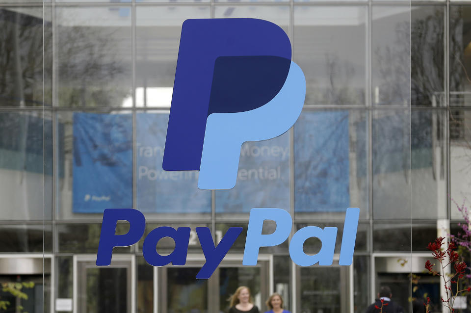 FILE - This March 10, 2015, file photo, shows signage outside PayPal headquarters in San Jose, Calif. PayPal reports financial results on Wednesday, April 27, 2016. (AP Photo/Jeff Chiu, File)