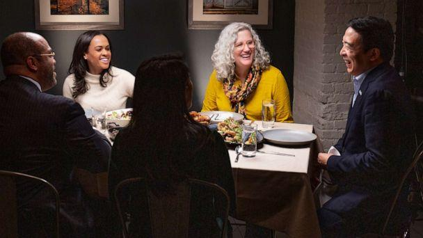 PHOTO: Democratic presidential candidate Andrew Yang, right, joins ABC's Linsey Davis, second from left and voters Ramsey Smith, Jaslin Kaur and Mara Novak for dinner. (Arturo Holmes/ABC)