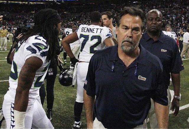 St. Louis Rams head coach Jeff Fisher leaves the field after an NFL football game against the Seattle Seahawks, Monday, Oct. 28, 2013, in St. Louis. The Seahawks won 14-9. (AP Photo/Tom Gannam)