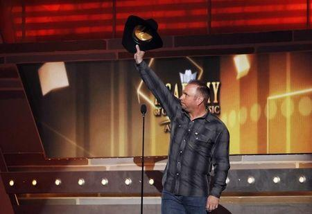 Garth Brooks waves while on stage at the 49th Annual Academy of Country Music Awards in Las Vegas
