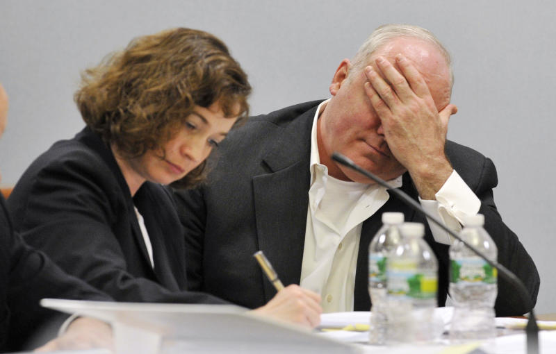 Michael Skakel, right, listens to the cross examination of his former defense attorney, Mickey Sherman, at Skakel's habeas corpus hearing at State Superior Court in Vernon, Conn., on Wednesday, April 17, 2013. (AP Photo/The Stamford Advocate, Jason Rearick , pool)