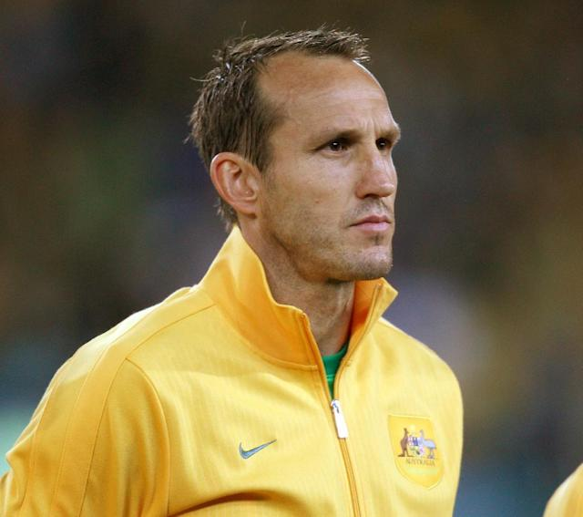 Australia's goal keeper Mark Schwarzer stands for the national anthem before playing Iraq in their World Cup soccer Asian qualifying match at the Sydney Olympic Stadium in Sydney, Australia, Tuesday, June 18, 2013. Australia won the match 1-0 and qualify for the 2014 World Cup in Brazil. (AP Photo/Rick Rycroft)