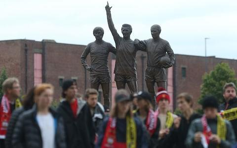 The 'Holy Trinity' statue at Old Trafford is a focal point not only for fans of Best, Law and Charlton - Credit: John Peters/Man Utd via Getty Images