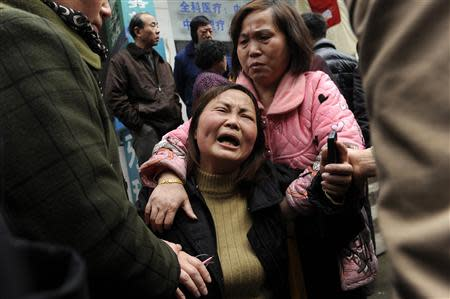 A woman cries after her parent was killed in a knifing incident in Changsha, Hunan province