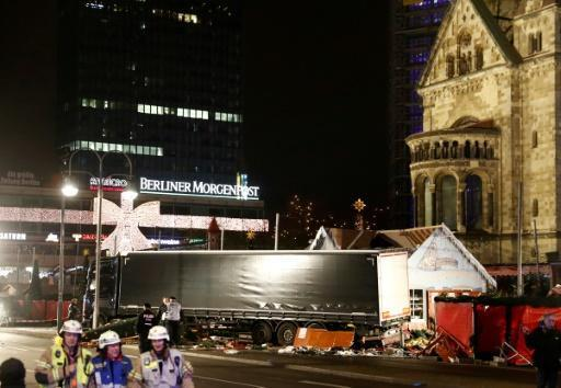 IS claims Berlin truck attack, suspect at large