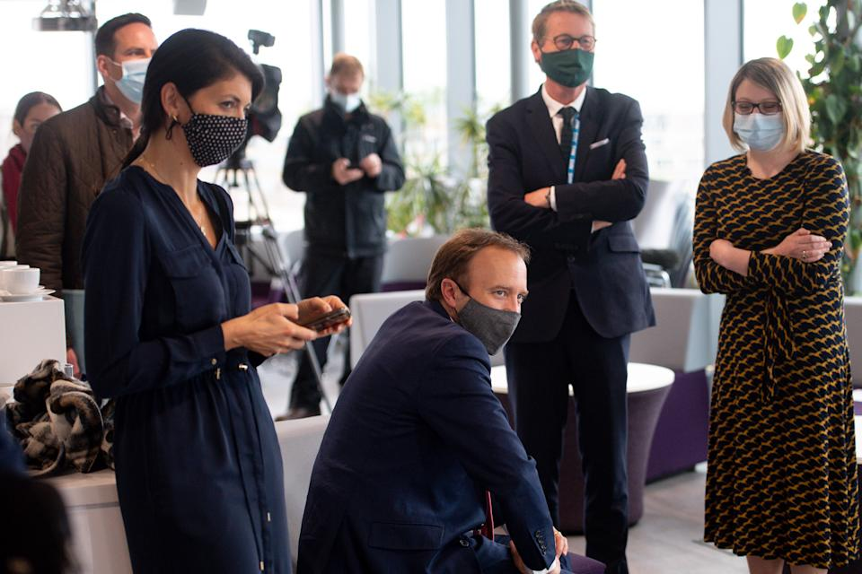 Matt Hancock (centre, sitting) with adviser Gina Coladangelo (left) at the launch of Pfizer's Vaccine Centre of Excellence at the University of Bristol on 25 May. (PA)