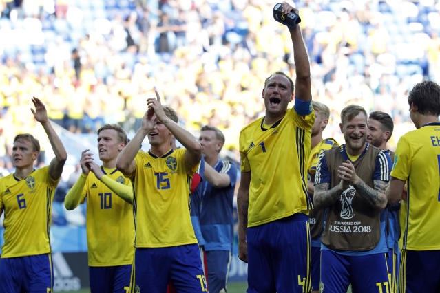 Sweden's Andreas Granqvist, third right, celebrates with teammates after the group F match between Sweden and South Korea at the 2018 soccer World Cup in the Nizhny Novgorod stadium in Nizhny Novgorod, Russia, Monday, June 18, 2018. Sweden won 1-0. (AP Photo/Pavel Golovkin)