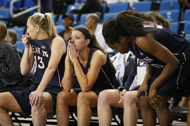 Penn forward Jackie Falconer, center, and Penn guard Kasey Chambers, left, sit on the bench late in the second half of a first-round game against Texas A&M in the NCAA women's college basketball tournament, Saturday, March 18, 2017, in Los Angeles. Texas A&M won 63-61. (AP Photo/Danny Moloshok)
