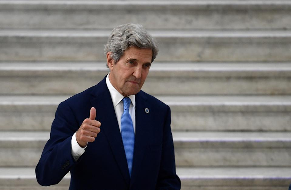 US Special Presidential Envoy for Climate John Kerry (L) gives a thumbs up whilst meeting with Italy's Ecological Transition Minister Roberto Cingolani at Palazzo Reale for the climate and energy G20 meeting in the historical centre of Naples on July 23, 2021. (Photo by Filippo MONTEFORTE / AFP) (Photo by FILIPPO MONTEFORTE/AFP via Getty Images)
