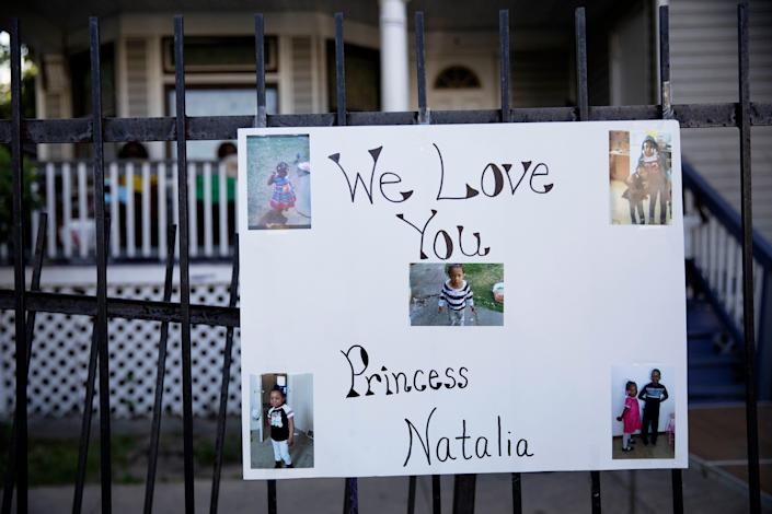 A poster with photos are attached to a fence in the South Austin neighborhood of Chicago on Sunday, July 5, 2020, during a vigil for 7-year-old Natalie Wallace, who was shot and killed as her family gathered to celebrate the Fourth of July.