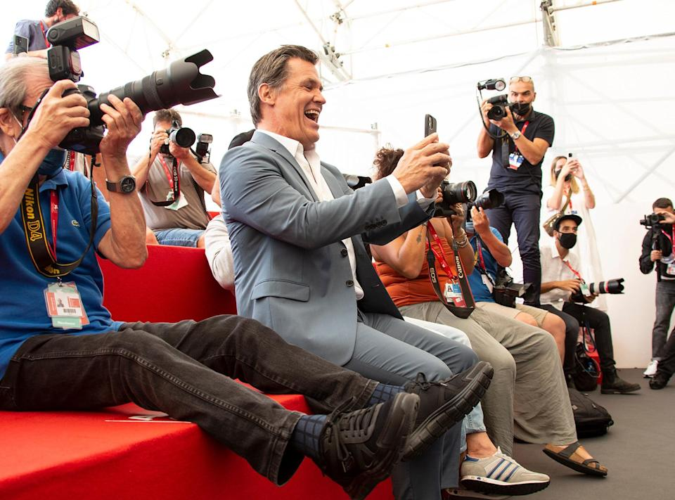 <p>Josh Brolin joins the photographers at the photocall for the film <em>Dune</em> during the Venice Film Festival on Sept. 3.</p>