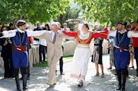 <p>During Prince Charles and Camilla Parker-Bowles' 2018 trip to Greece, the couple enjoyed a spot of Greek dancing with locals in Crete on May 11. <em>[Photo: Getty]</em> </p>